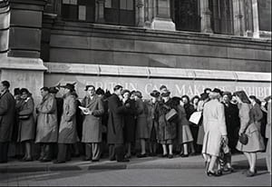 Black and white photo of people waiting to enter the Britain Can Make It Exhibition