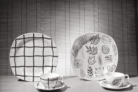 A black and white photograph showing decorated plates, cups and saucers manufactured by W R Midwinter in 1954. Taken from the Design Council Archive housed at the University of Brighton Design Archives.