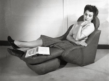 A black and white image of a woman on a reclining sofa chair. Taken from the Design Council Archive housed at the University of Brighton Design Archives.