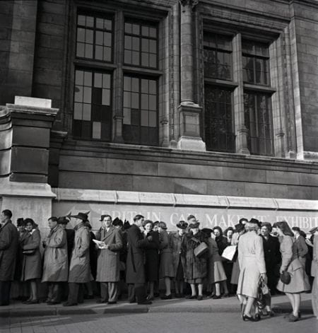 A black and white photograph of people queuing to get into the Britain Can Make It Exhibition, 1951.