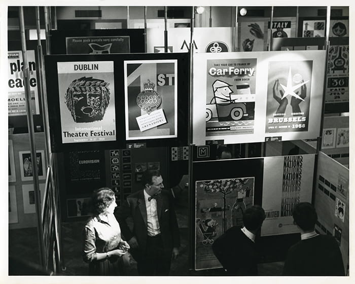 A black and white photograph from The Pack Age - an exhibition of packaging designed by members of the Society of Industrial Artists and Designers, Design Centre, London (1965), showing HA Rothholz's posters. Taken from the HA Rothholz Archive housed at the University of Brighton Design Archives.