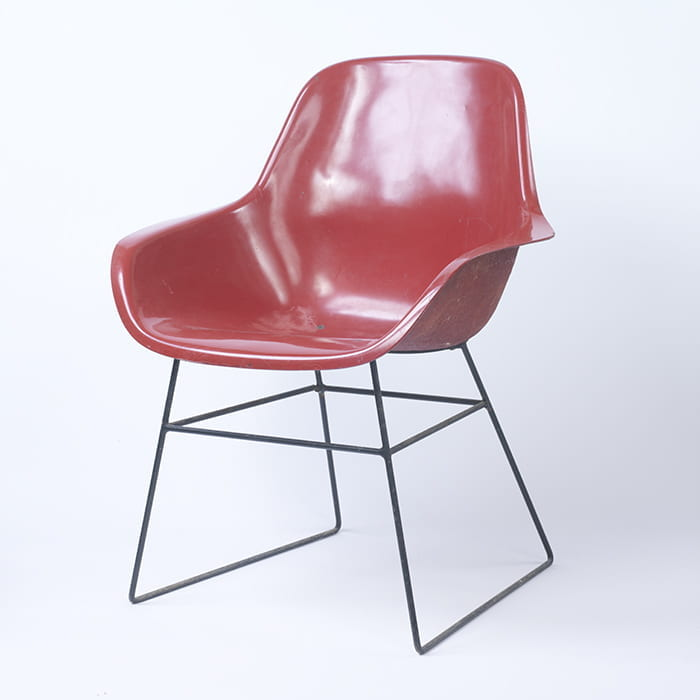 A red plastic and metal chair designed by Bernard Schottlander in the 1950s. Taken from the Bernard Schottlander Archive housed at the University of Brighton Design Archives.