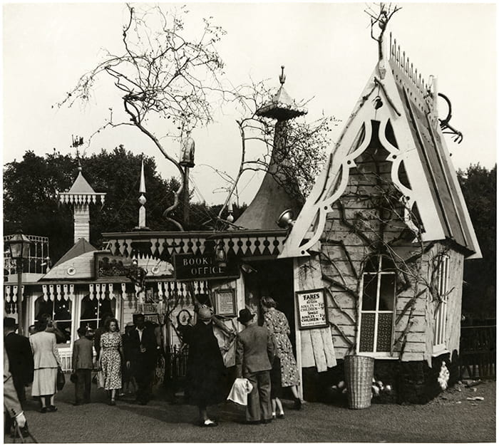 A black and white photograph of the Far Tottering & Oyster Creek Railway booking office and station buffet from the Festival of Britain Pleasure Gardens (1951). Designed by Rowland Emett. Architect: Harrison & Seel. Taken from the James Gardner Archive housed at the University of Brighton Design Archives.