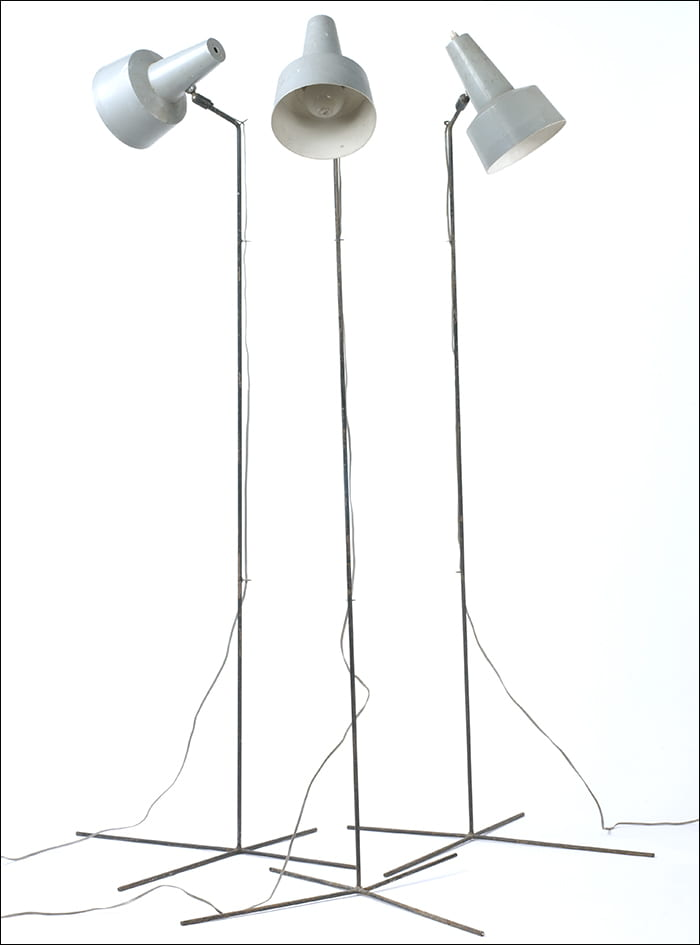 A colour photograph of three floor lamps with grey reflectors. Designed by Bernard Schottlander in the 1950s. Taken from the Bernard Schottlander Archive housed at the University of Brighton Design Archives.