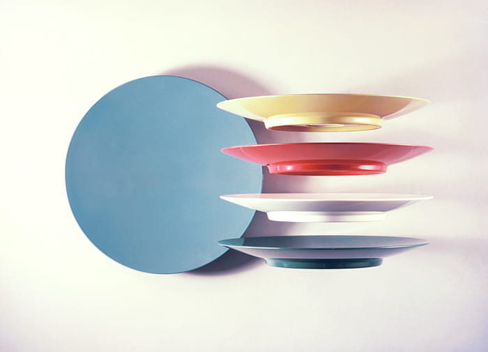 A colour photograph showing Fiesta melamime plates, winner of Duke of Edinburgh's Prize for Elegant Design in 1960. Designed by Ronald E Brookes and manufactured by Brookes and Adams Ltd. Take from the Design Council Archive housed at the University of Brighton Design Archives.