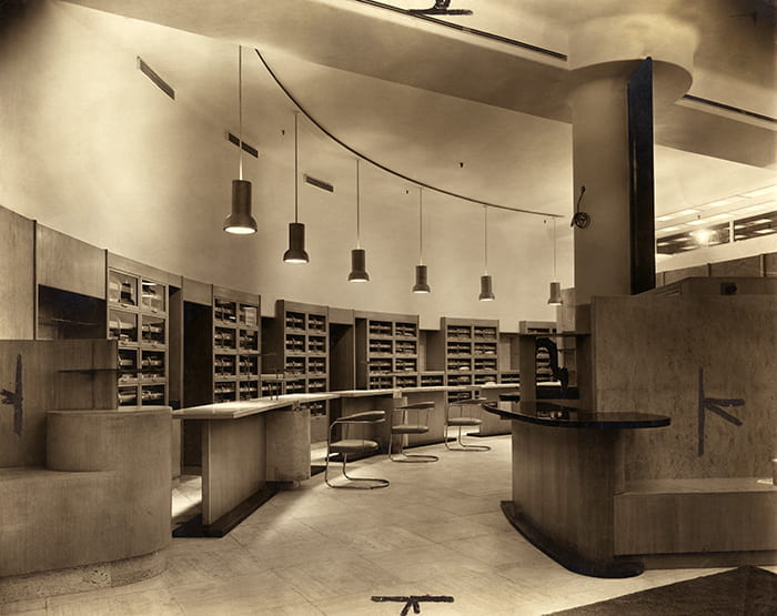 A black and white photograph showing the interior of outfitting department on the ground floor of Simpson Piccadilly (Ltd) in 1936. Photograph by Arkin Bros Commercial Photographers. Taken from the Joseph Emberton Archive housed at the University of Brighton Design Archives.