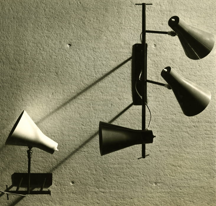 A black and white photograph of metal wall lamps (no date) designed by Bernard Schottlander. Taken from the Bernard Schottlander Archive housed at the University of Brighton Design Archives.