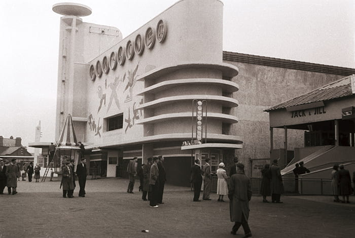 A black and white photograph showing the exterior of the Funhouse at Blackpool Pleasure Beach in 1953. Taken from the Joseph Emberton Archive housed at the University of Brighton Design Archives.