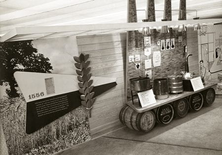 Black and white photo showing exhibition display on the making of whiskey at Farm and Factory Exhibition, Northern Ireland. Festival of Britain 1951
