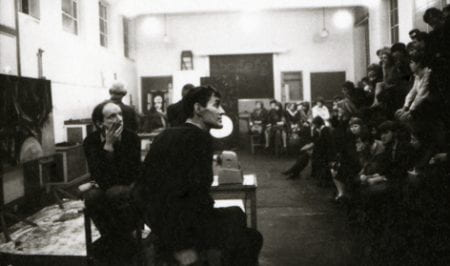 Black and white photograph of Anthony Froshaug teaching a class