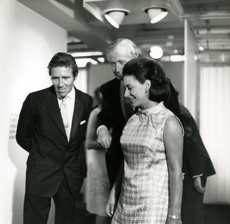 Black and white photograph of Princess Margaret and her then husband Earl of Snowdon visiting the Design Centre at the Haymarket in London