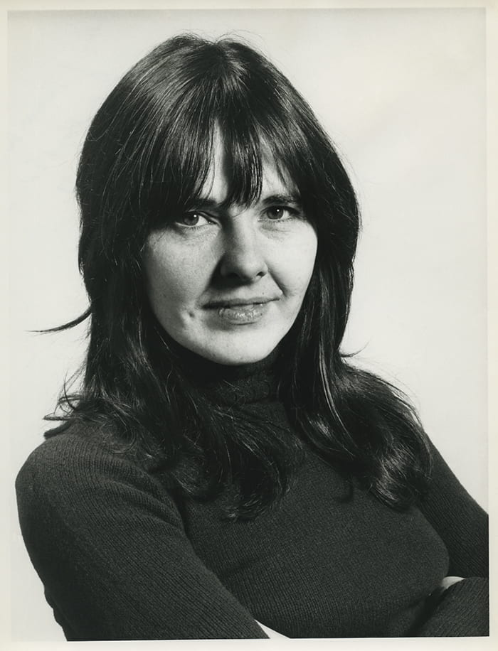 Black and white portrait of Barbara Brown wearing a polo-neck and looking at the camera