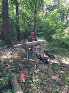 saw mill set up to cut oak planks with chainsaw