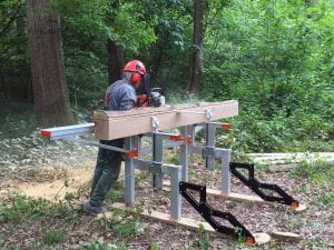 cutting oak planks with a chainsaw