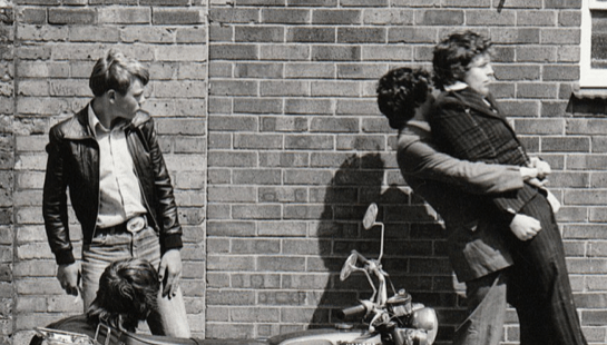 boys and a motorcycle