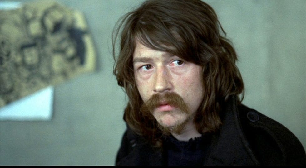 John Hurt as Little Malcolm