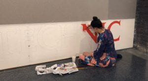 Emma painting walls