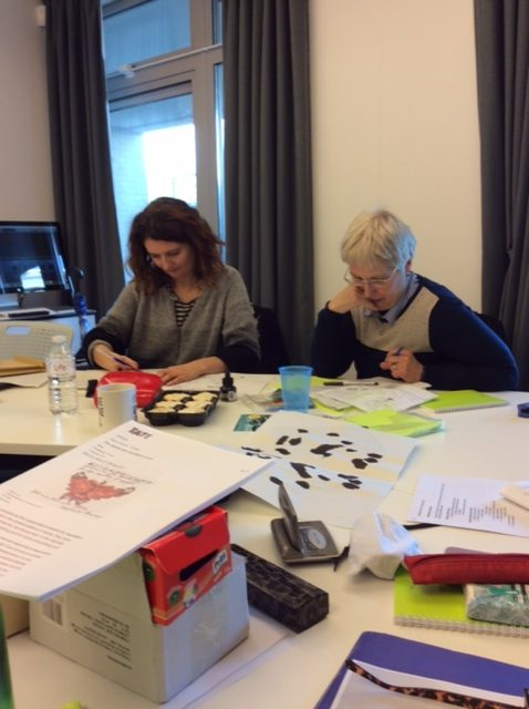 Polly Blake and Sandie Woods trying out new materials at a collaborative poetics workshop