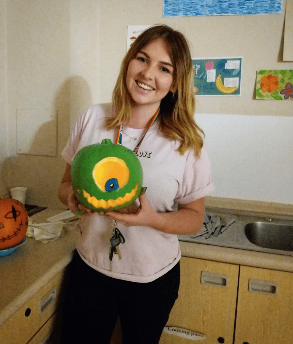 Shannon Edmunds holding a carved pumpkin