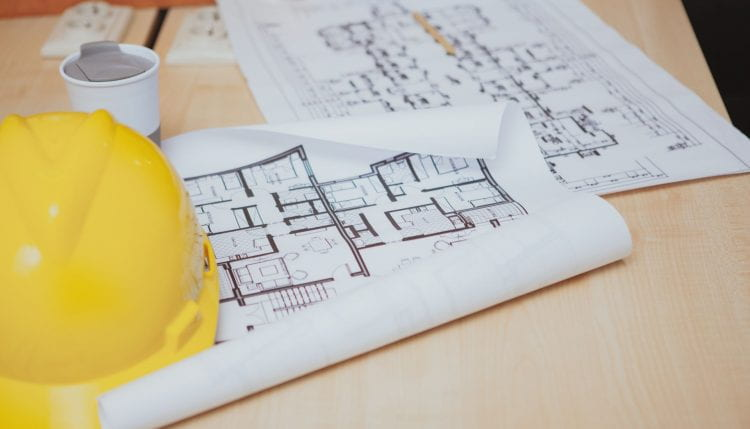 Image of a hard hat on blue print documents
