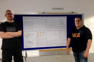Simon presenting his MChem poster with supervisor Dr Ian Gass