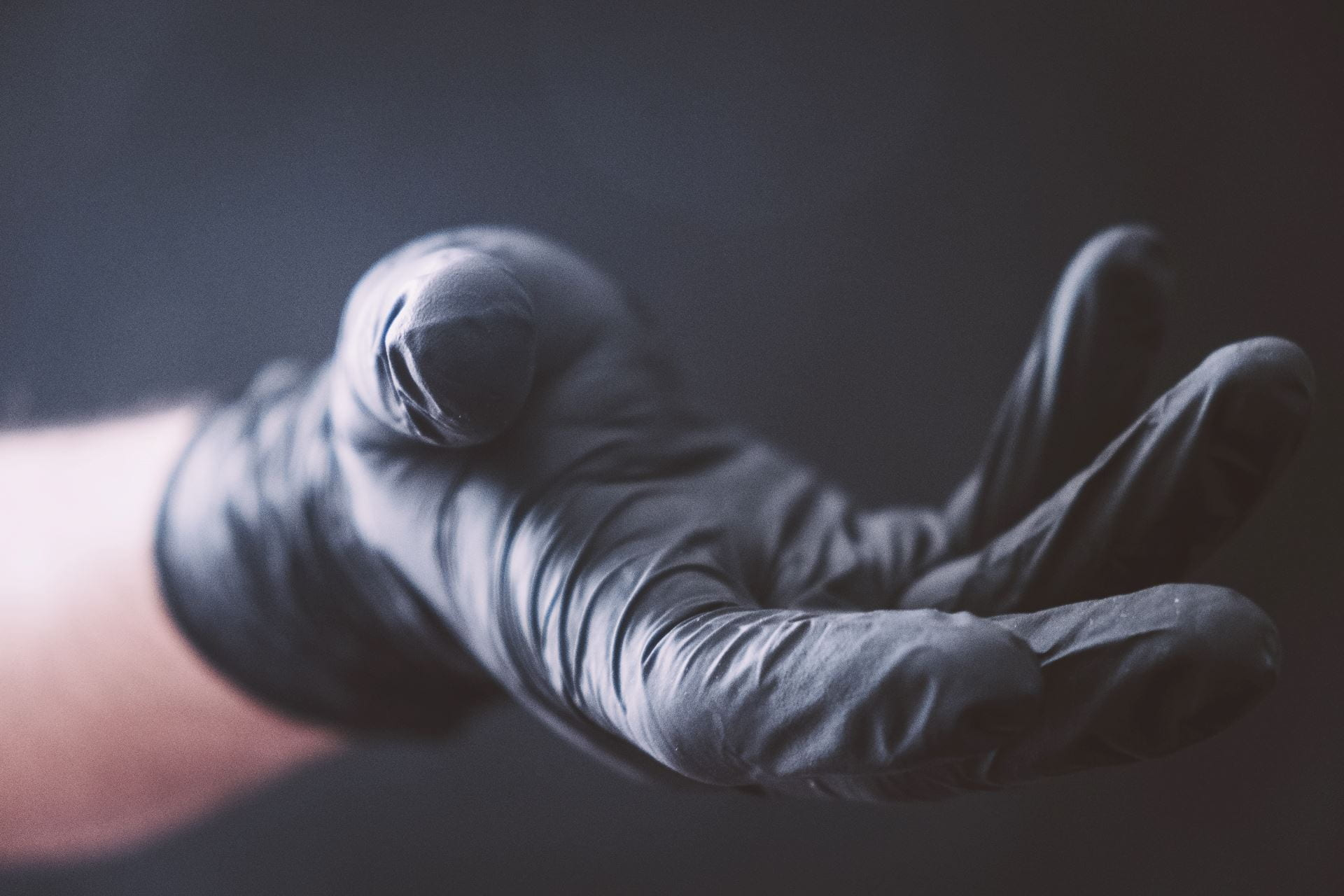 a photo of a gloved hand