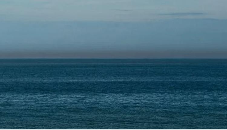 photo of a calm blue sea