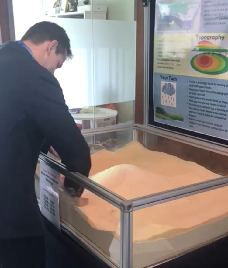 James Cole demonstrating the sand box