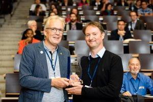 Dr James Ebdon accepts the award on behalf of Professor Huw Taylor
