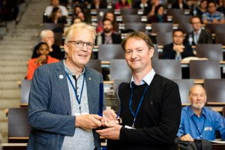 Dr James Ebdon accepts the award on behalf of Professor Huw Taylor