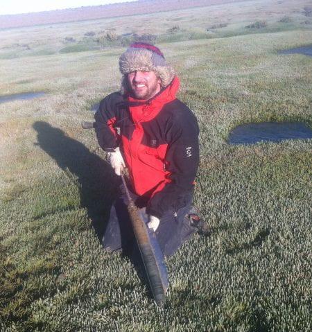 Dr Ward in a field