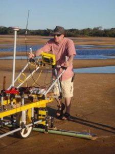 Professor Phil Ashworth using ground penetrating radar for flood research