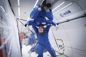 Two students from team PHP Cubed in zero gravity