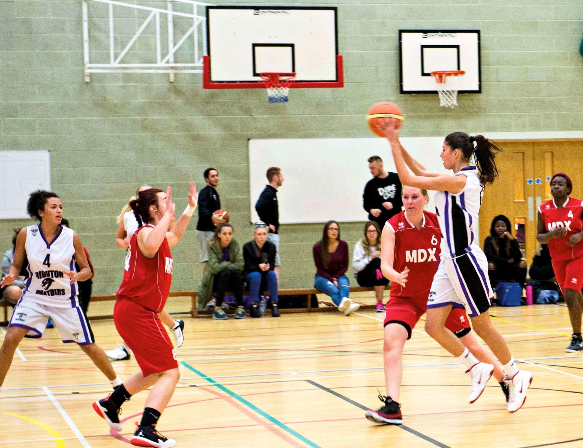 Brighton University basketball team playing.