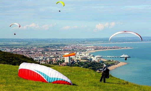 Paragliders enjoying the beautifull weather high over Beachy Head and Eastbourne in East Sussex.