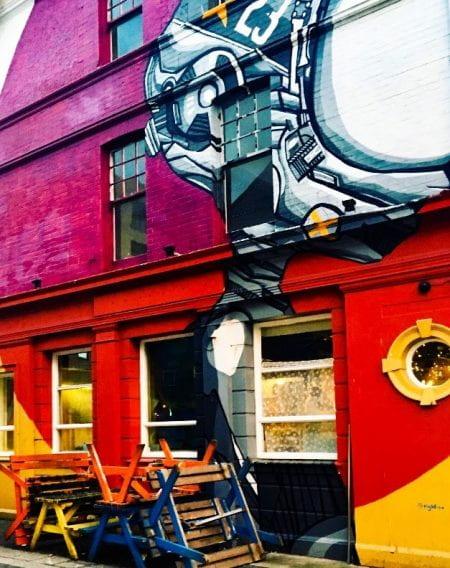 Presuming Eds colourful graffiti shop front