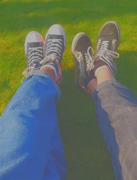 Deborah and a friend sitting in Gildredge park