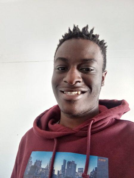 Emmanuel smiling at the camera