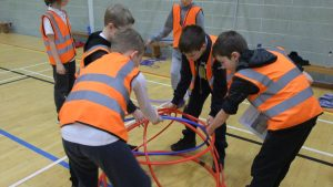 Photo of the children playing with hula hoops