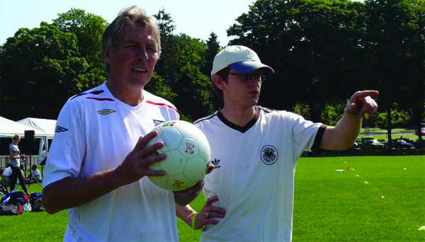 Professor Sugden holding a football