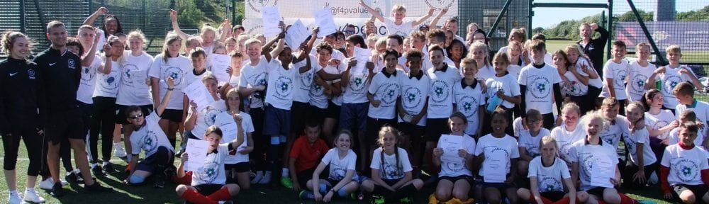 Group shot of the children on the football peace.