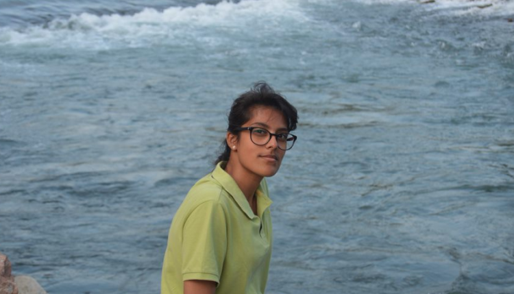 Student Zahin in front of the sea