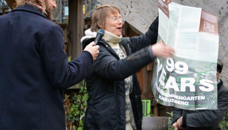 Artist Åsa Sonjasdotter enfolds Bonnie Fortune and Brett Bloom's Deep Map of Prinzessinnengarten during the 'communal ritual for the end and a new beginning' in December 2019. (source: Bohn&Viljoen 2019)