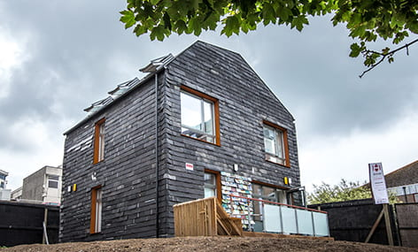 The Brighton Waste House, 'Europe's first permanent building made of materials other people discarded'. Its concept and building was coordinated by Duncan Baker-Brown. (source: University of Brighton www 2020)