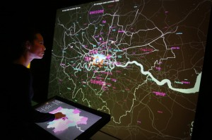 LONDON, ENGLAND - DECEMBER 02: A staff member interacts with a live social media map of London at the Big Bang Data exhibition at Somerset House on December 2, 2015 in London, England. The show highlights the data explosion that's radically transforming our lives. It opens on December 3, 2015 and runs until February 28, 2016 at Somerset House. (Photo by Peter Macdiarmid/Getty Images for Somerset House)