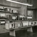 A black and white photo of a radio sales room in a department store