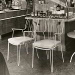 Black and white photo of showcase chairs and table in a grocery store setting