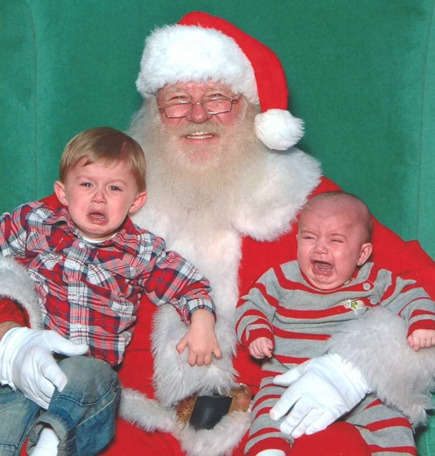 Father Christmas with two unhappy children
