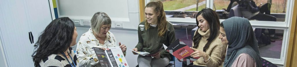 Students sat around with a careers adviser