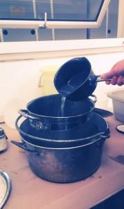 Adding washing soda to the pan